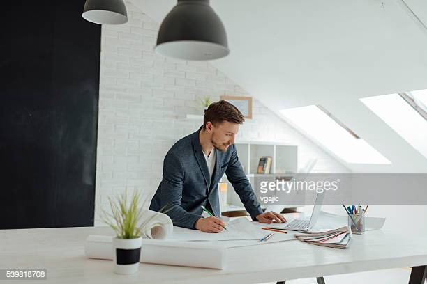 Designer Working In His New Office.
