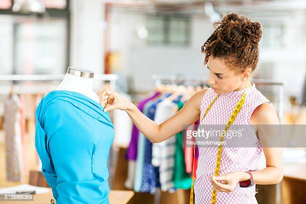 Designer Working On Dress In Fashion Workshop