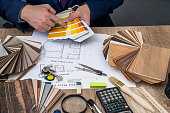 designer working with architect sketching construction project on wooden table
