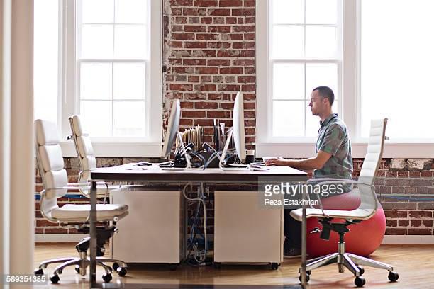 Designer works at computer
