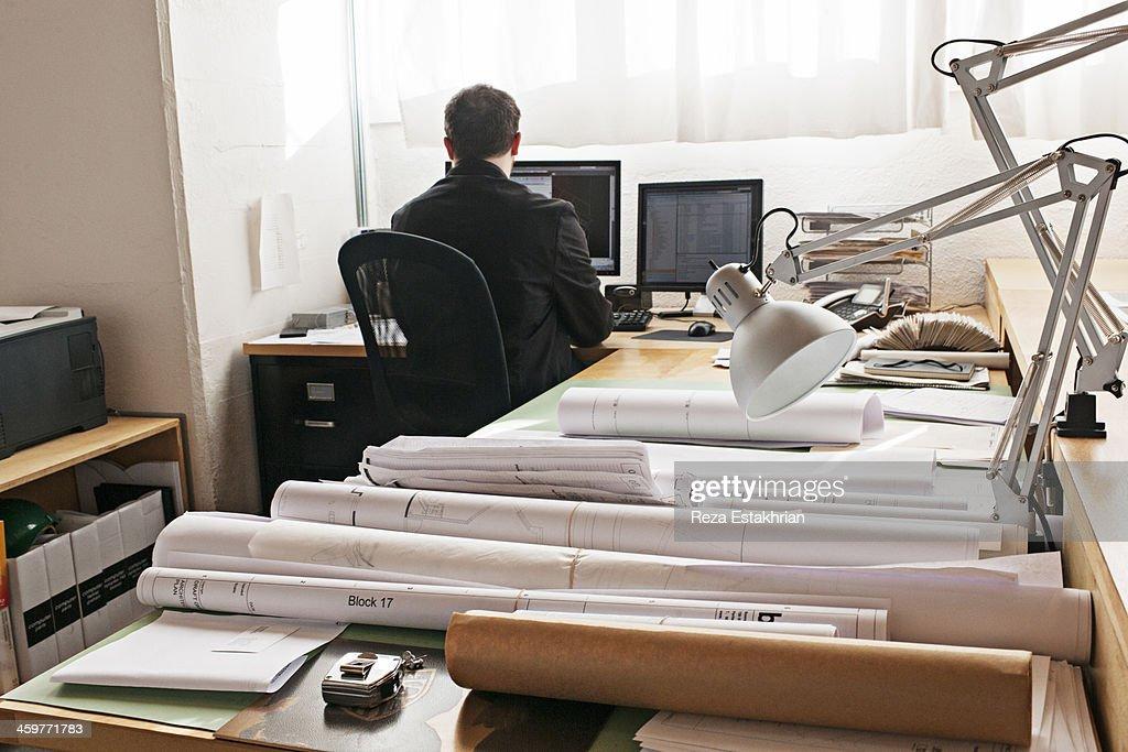 Designer works on computer : Stock Photo