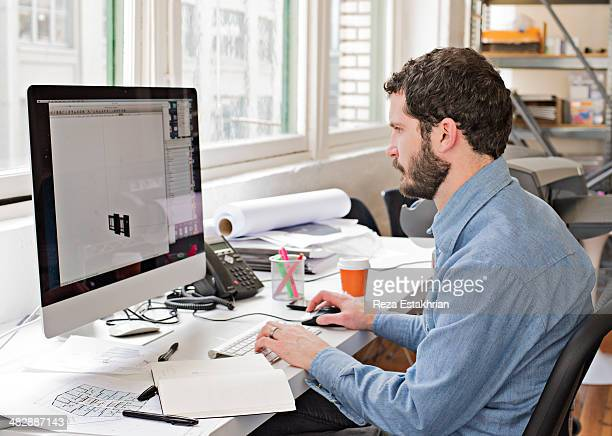 Designer works on computer