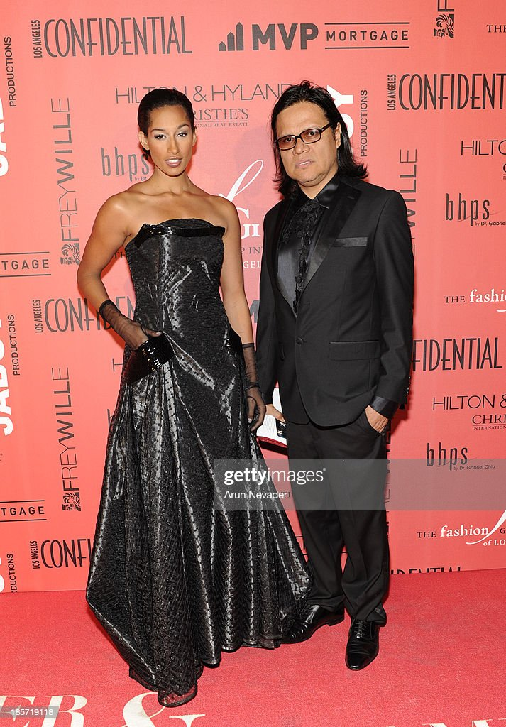 Designer Xavier Othon (R) and his muse, model Kiara Belen, arrive at the 5th Annual Designer & The Muse Hosted By Kathy Hilton at Mr. C Beverly Hills on October 23, 2013 in Beverly Hills, California.