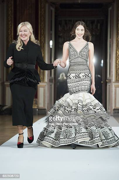 Designer Yanina and a model walks the runway during the Yanina Couture Spring Summer 2017 show as part of Paris Fashion Week on January 23 2017 in...