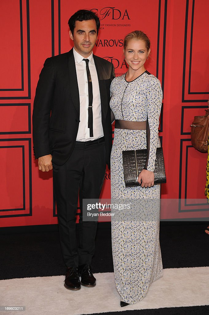 Designer Yigal Azrouel (L) and Teresa Palmer attend 2013 CFDA FASHION AWARDS Underwritten By Swarovski - Red Carpet Arrivals at Lincoln Center on June 3, 2013 in New York City.