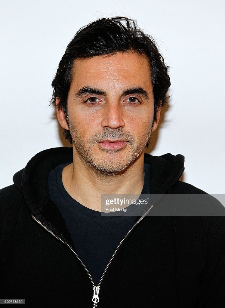 Designer Yigal Azrouel poses for a photo backstage at the Yigal Azrouel Fall 2016 fashion show during New York Fashion Week: The Shows at The Gallery, Skylight at Clarkson Sq on February 12, 2016 in New York City.