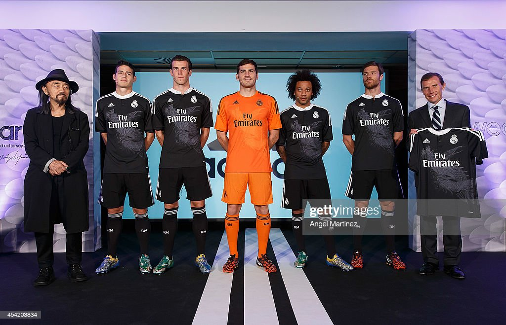 Designer Yohji Yamamoto, James Rodriguez, Gareth Bale, Iker Casillas, Marcelo Vieira, Xabi Alonso of Real Madrid and former player Emilio Butragueno during the Adidas 3rd kit launch at Estadio Santiago Bernabeu on August 26, 2014 in Madrid, Spain.