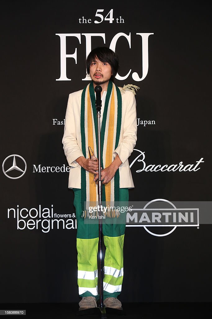 Designer Yoshikazu Yamagata of writtenafterwards receives the Rookie of the Year award during the 54th Fashion Editors Club of Japan Awards at Mercedes-Benz Connection on December 14, 2012 in Tokyo, Japan.