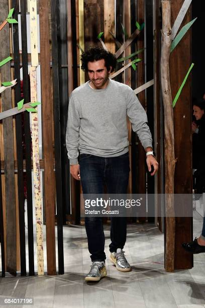 Designer Yousef Akbar thanks the audience following the Yousef Akbar show at MercedesBenz Fashion Week Resort 18 Collections at Carriageworks on May...