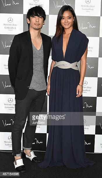 Designer Yu Amatsu and model Jarah Mariano attends the photocall during the HANAE MORI designed by Yu Amatsu show as part of Mercedes Benz Fashion...
