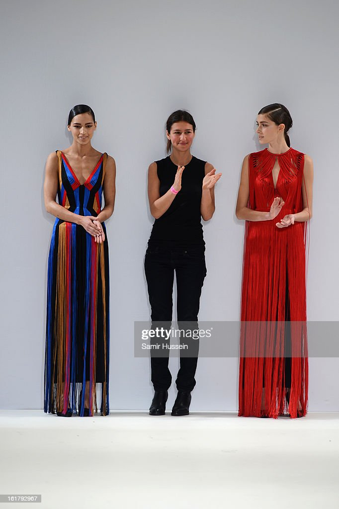 Designer Yulia Kondanina (C) walks the runway with models wearing her designs at the Ones To Watch show during London Fashion Week Fall/Winter 2013/14 at Freemasons Hall on February 16, 2013 in London, England.