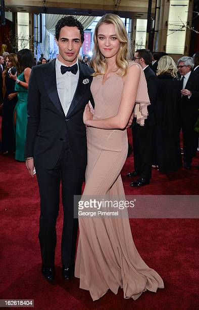 Designer Zac Posen and guest arrive at the Oscars at Hollywood Highland Center on February 24 2013 in Hollywood California at Hollywood Highland...