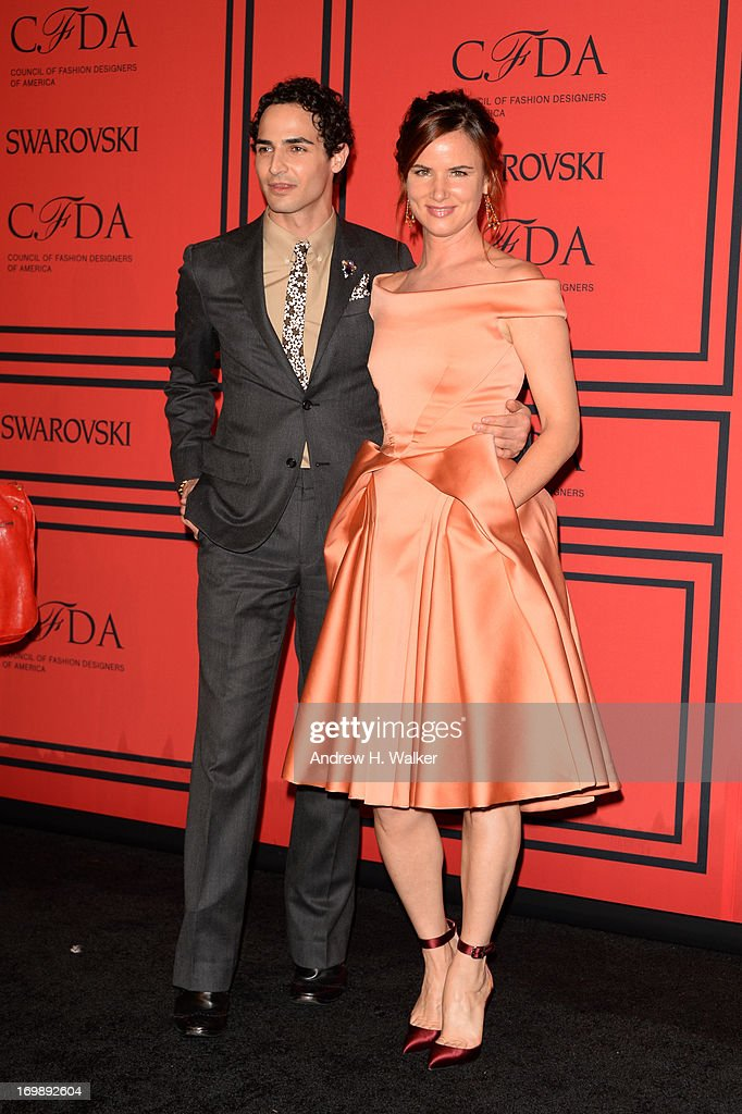 Designer Zac Posen (L) and Juliette Lewis attend 2013 CFDA Fashion Awards at Alice Tully Hall on June 3, 2013 in New York City.