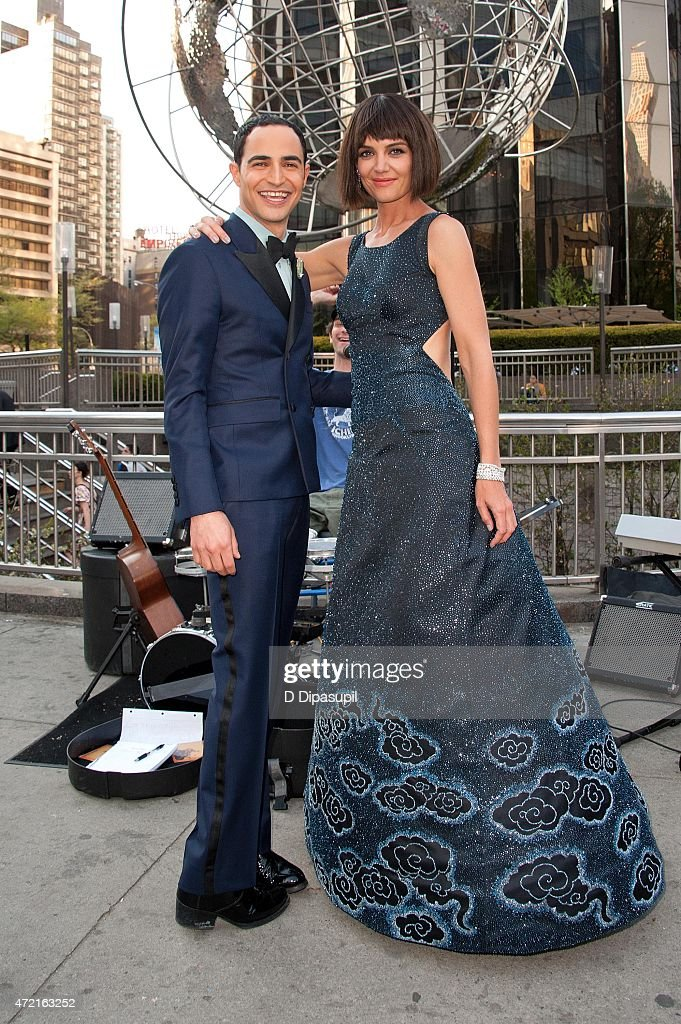 Designer Zac Posen and Katie Holmes pose on the streets of Manhattan before heading to the Costume Institute Benefit Gala on May 4 2015 in New York...