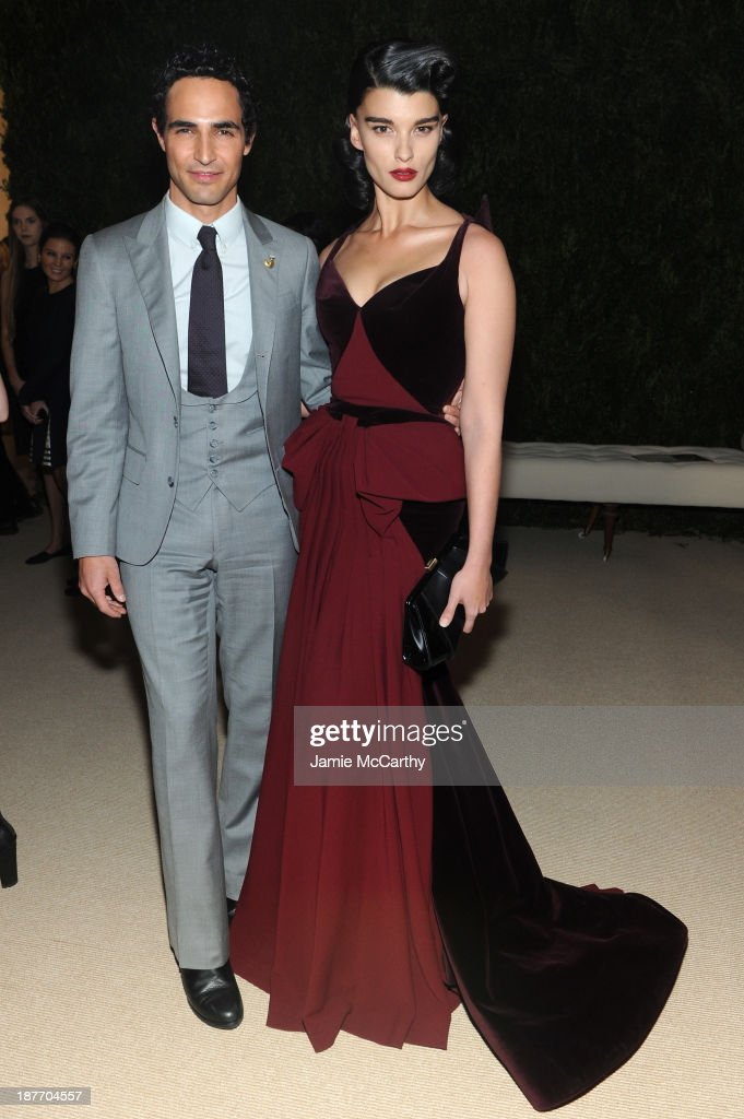 Designer Zac Posen and model <a gi-track='captionPersonalityLinkClicked' href=/galleries/search?phrase=Crystal+Renn&family=editorial&specificpeople=2216376 ng-click='$event.stopPropagation()'>Crystal Renn</a> attend CFDA and Vogue 2013 Fashion Fund Finalists Celebration at Spring Studios on November 11, 2013 in New York City.