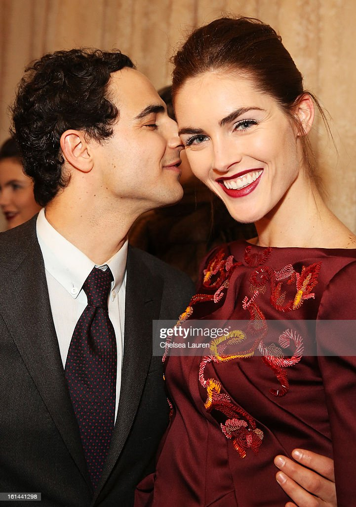 Designer Zac Posen and model <a gi-track='captionPersonalityLinkClicked' href=/galleries/search?phrase=Hilary+Rhoda&family=editorial&specificpeople=637945 ng-click='$event.stopPropagation()'>Hilary Rhoda</a> prepare backstage at the Zac Posen Fall 2013 fashion show during Mercedes-Benz Fashion Week on February 10, 2013 in New York City.