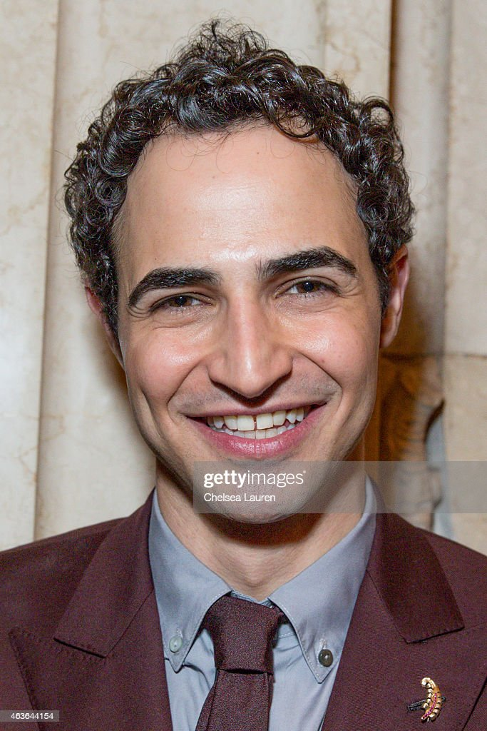 Designer Zac Posen poses backstage after his fashion show at Vanderbilt Hall at Grand Central Terminal on February 16 2015 in New York City