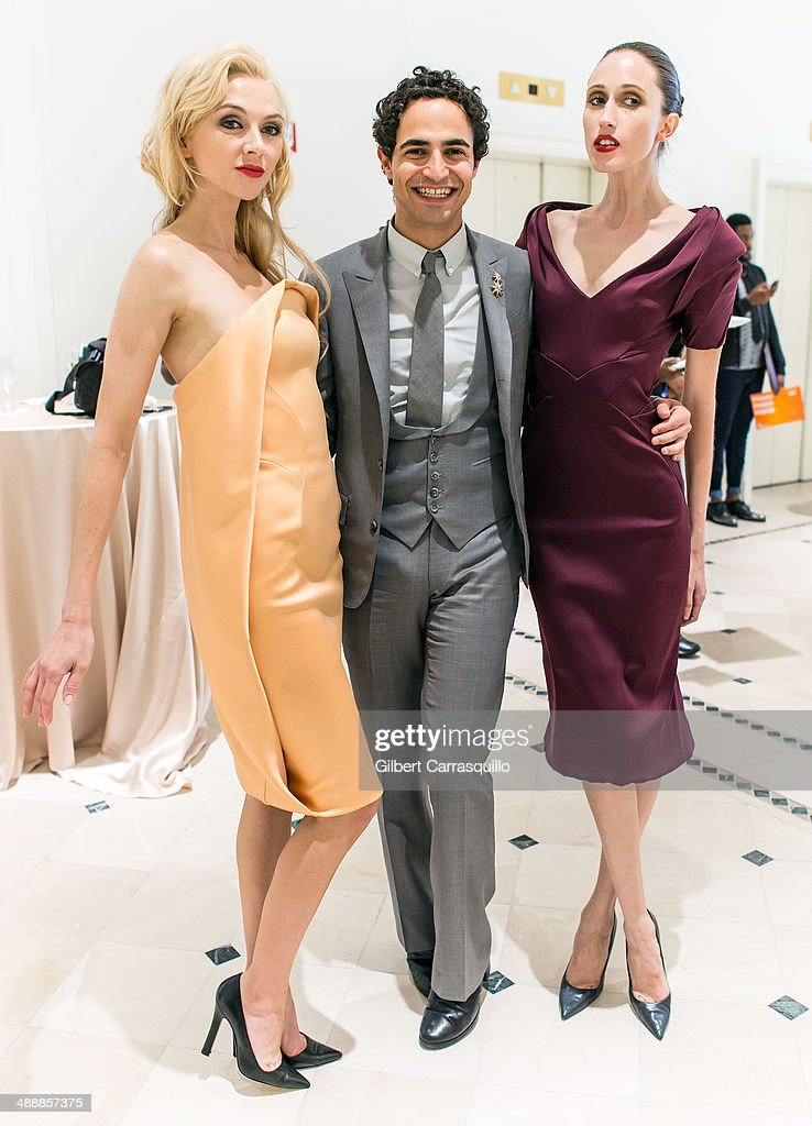 Designer <a gi-track='captionPersonalityLinkClicked' href=/galleries/search?phrase=Zac+Posen+-+Fashion+Designer&family=editorial&specificpeople=4442066 ng-click='$event.stopPropagation()'>Zac Posen</a> (center) poses with models Marla Weaver (L) and <a gi-track='captionPersonalityLinkClicked' href=/galleries/search?phrase=Anna+Cleveland&family=editorial&specificpeople=2569978 ng-click='$event.stopPropagation()'>Anna Cleveland</a> (R) during the <a gi-track='captionPersonalityLinkClicked' href=/galleries/search?phrase=Zac+Posen+-+Fashion+Designer&family=editorial&specificpeople=4442066 ng-click='$event.stopPropagation()'>Zac Posen</a> Pre-Fall And Fall 2014 Collections Preview at Saks Fifth Avenue on May 8, 2014 in Bala-Cynwyd, Pennsylvania.