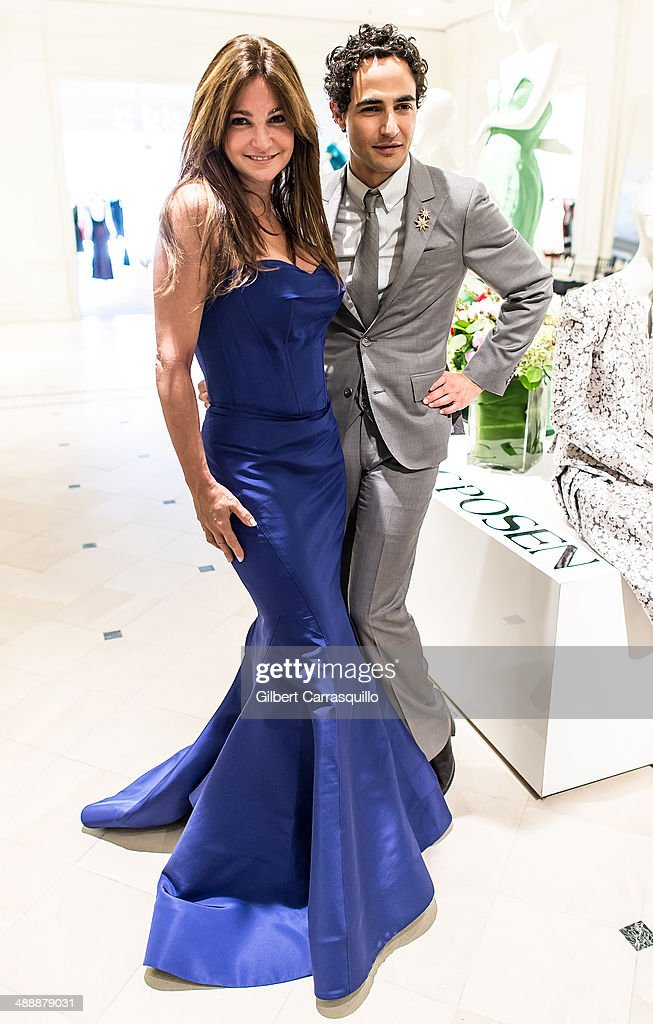 Designer Zac Posen (R) poses with Professional poker player/TV personality Beth Shak during the Zac Posen Pre-Fall And Fall 2014 Collections Preview at Saks Fifth Avenue on May 8, 2014 in Bala-Cynwyd, Pennsylvania.