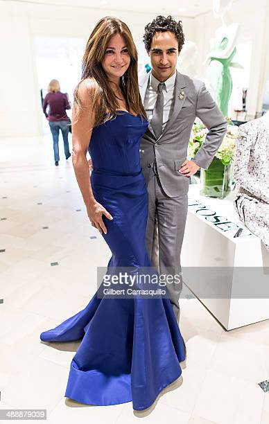 Designer Zac Posen poses with Professional poker player/TV personality Beth Shak during the Zac Posen PreFall And Fall 2014 Collections Preview at...