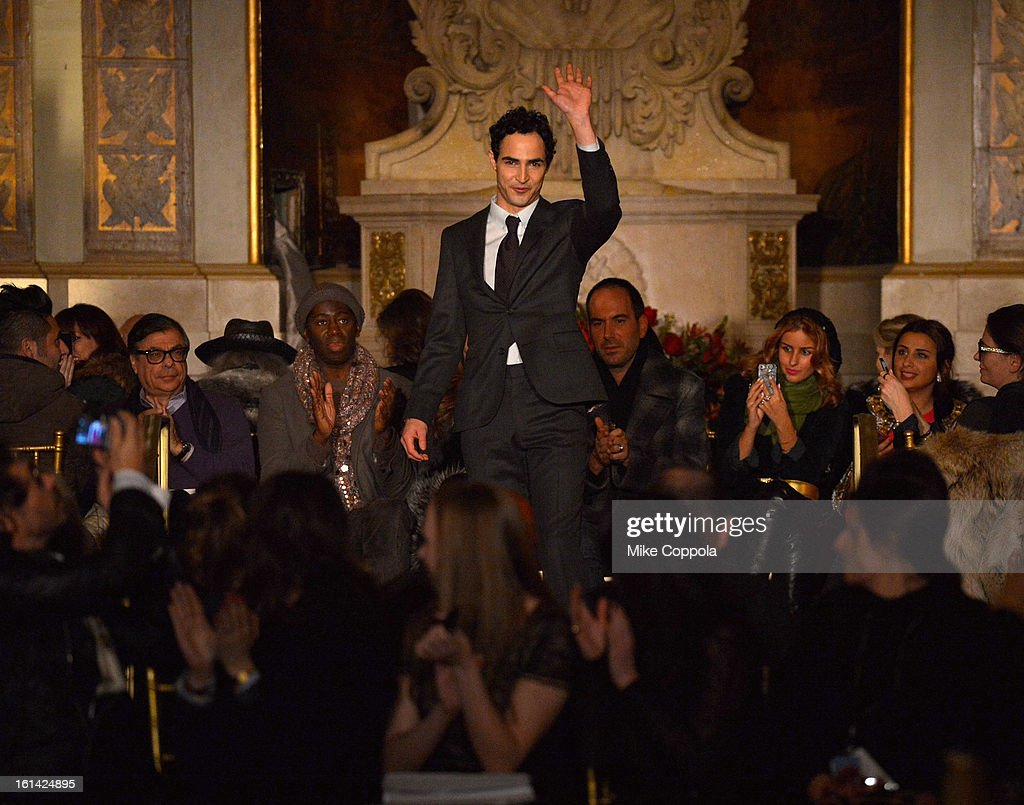 designer Zac Posen walks the runway at the Zac Posen Fall 2013 fashion show during Mercedes-Benz Fashion Week at at Lincoln Center on February 10, 2013 in New York City.