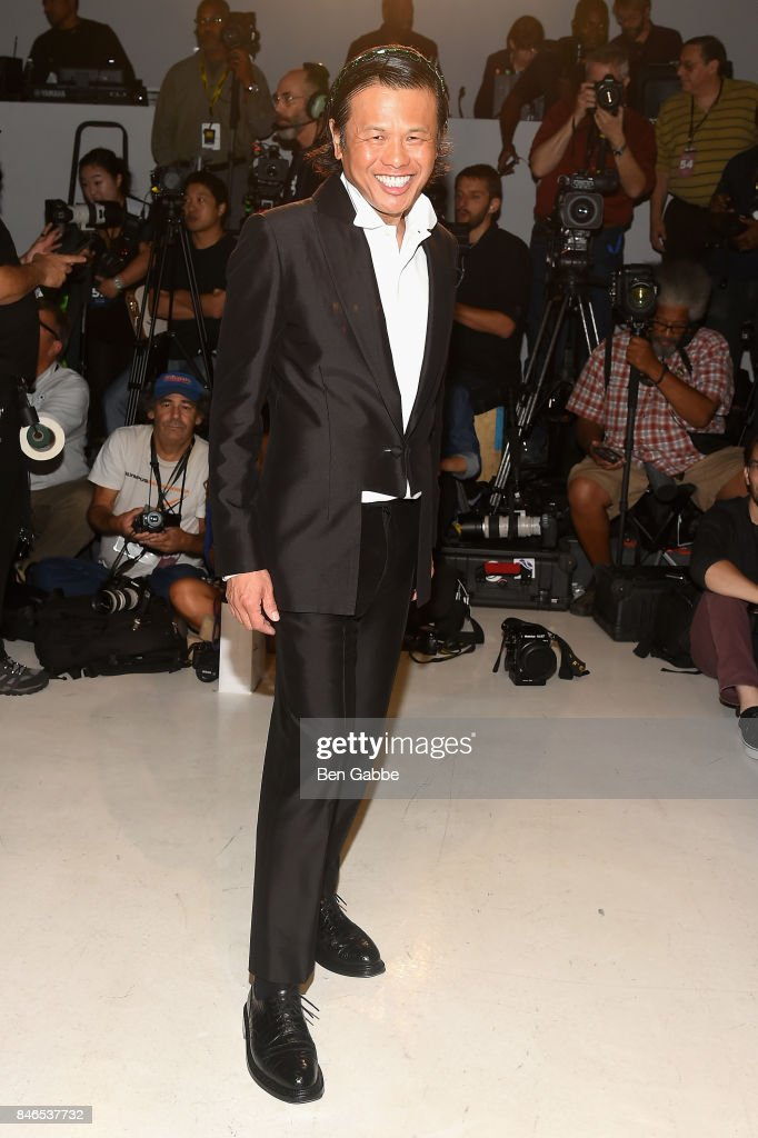 Designer Zang Toi poses on the runway for the Zang Toi fashion show during New York Fashion Week: The Shows at Gallery 3, Skylight Clarkson Sq on September 13, 2017 in New York City.