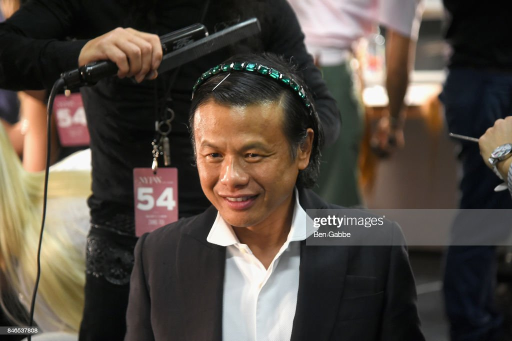 Designer Zang Toi prepares backstage for the Zang Toi fashion show during New York Fashion Week: The Shows at Gallery 3, Skylight Clarkson Sq on September 13, 2017 in New York City.