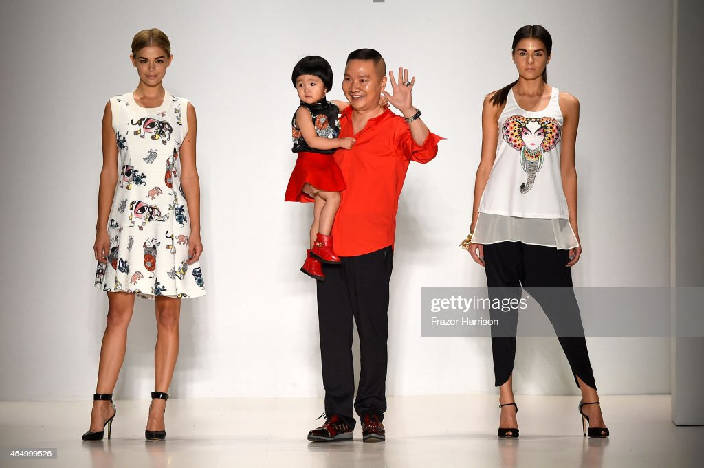 Designer <a gi-track='captionPersonalityLinkClicked' href=/galleries/search?phrase=Zhuliang+Li&family=editorial&specificpeople=13555976 ng-click='$event.stopPropagation()'>Zhuliang Li</a> (C) appears on the runway with model Danielle Knudson (L) and Miss Teen USA K. Lee Graham (R) at the Oudifu fashion show during Mercedes-Benz Fashion Week Spring 2015 at The Salon at Lincoln Center on September 8, 2014 in New York City.