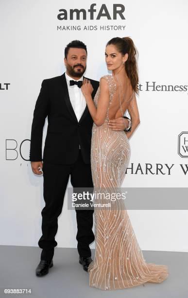 Designer Zuhair Murad and model Izabel Goulart arrive at the amfAR Gala Cannes 2017 at Hotel du CapEdenRoc on May 25 2017 in Cap d'Antibes France