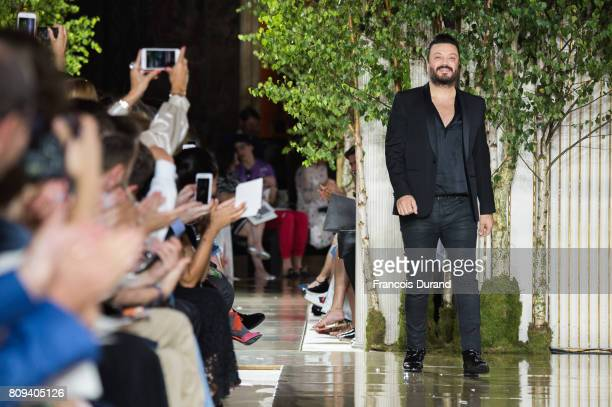 Designer Zuhair Murad walks the runway during the Zuhair Murad Haute Couture Fall/Winter 20172018 show as part of Haute Couture Paris Fashion Week on...