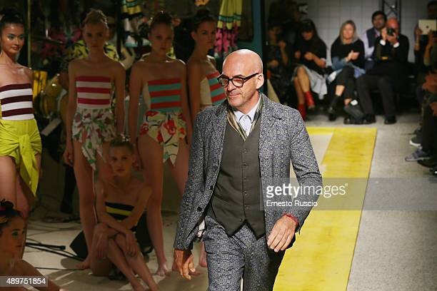 DesignerAntonio Marras acknowledges the applause of the audience after the runway during the Isola Marras fashion show as part of Milan Fashion Week...