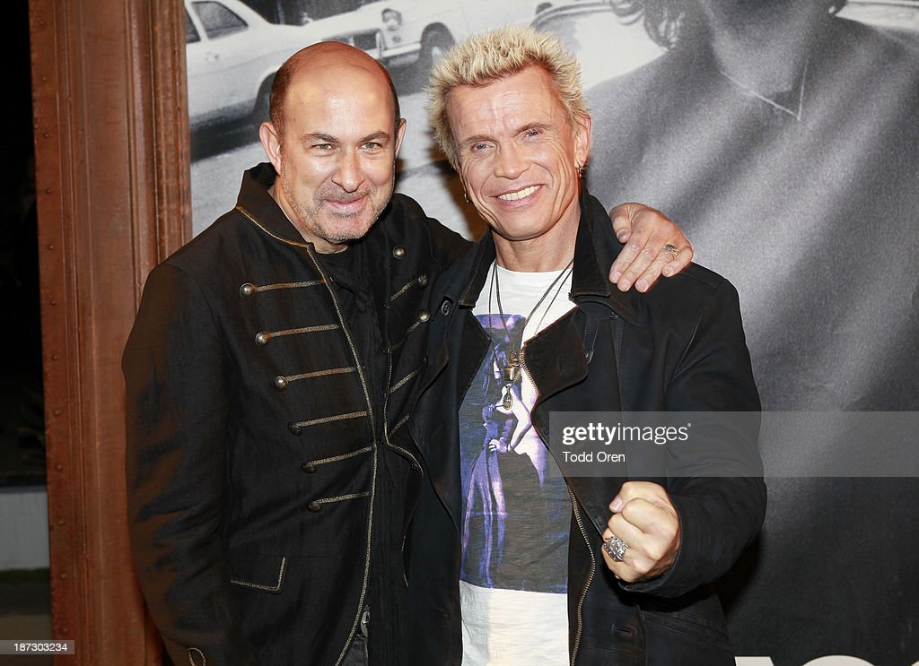Designer/author John Varvatos (L); musician Billy Idol (R) arrive at the 'John Varvatos: Rock In Fashion book launch celebration held at John Varvatos Los Angeles on November 7, 2013 in Los Angeles, California.