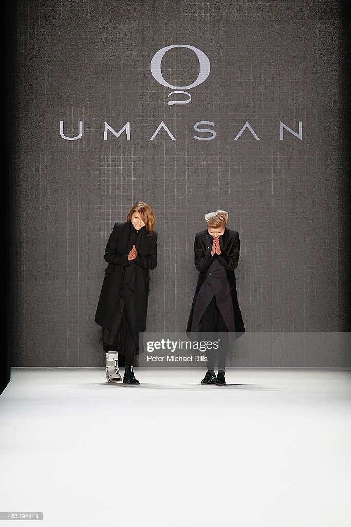 Designers Anja and Sandra Umann acknowledge the audience atfter the Umasan show during Mercedes-Benz Fashion Week Autumn/Winter 2014/15 at Brandenburg Gate on January 17, 2014 in Berlin, Germany.