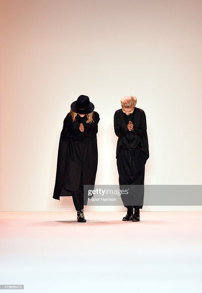 Designers Anja and Sandra Umann take a bow at the end of the Umasan Show during Mercedes-Benz Fashion Week Spring/Summer 2014 at Brandenburg Gate on July 5, 2013 in Berlin, Germany.