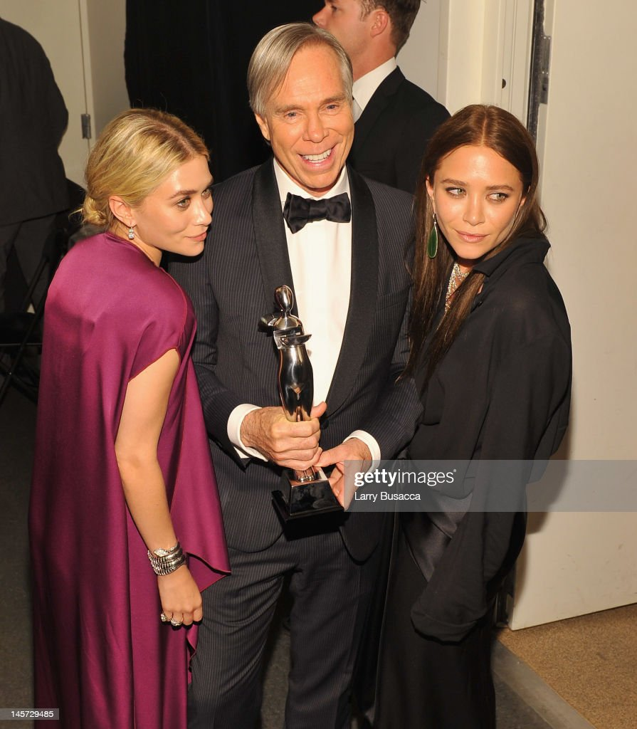Designers <a gi-track='captionPersonalityLinkClicked' href=/galleries/search?phrase=Ashley+Olsen&family=editorial&specificpeople=156429 ng-click='$event.stopPropagation()'>Ashley Olsen</a> and Mary Kate Olsen and Tommy Hilfiger pose with award at the 2012 CFDA Fashion Awards at Alice Tully Hall on June 4, 2012 in New York City.