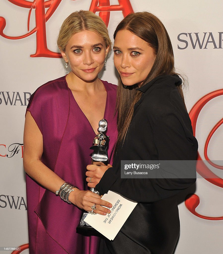 Designers <a gi-track='captionPersonalityLinkClicked' href=/galleries/search?phrase=Ashley+Olsen&family=editorial&specificpeople=156429 ng-click='$event.stopPropagation()'>Ashley Olsen</a> and Mary Kate Olsen pose with award at the 2012 CFDA Fashion Awards at Alice Tully Hall on June 4, 2012 in New York City.
