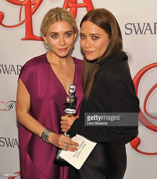 Designers Ashley Olsen and Mary Kate Olsen pose with award at the 2012 CFDA Fashion Awards at Alice Tully Hall on June 4 2012 in New York City