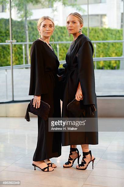 Designers Ashley Olsen and MaryKate Olsen attend the 2014 CFDA fashion awards at Alice Tully Hall Lincoln Center on June 2 2014 in New York City