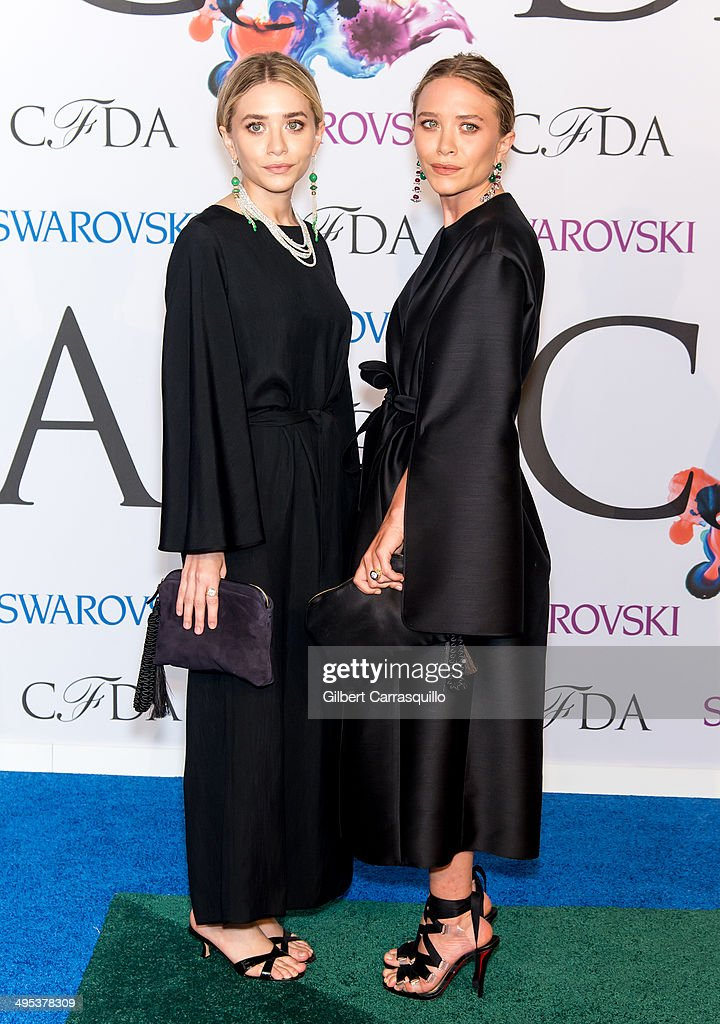 Designers Ashley Olsen (L) and Mary-Kate Olsen attend the 2014 CFDA fashion awards at Alice Tully Hall, Lincoln Center on June 2, 2014 in New York City.