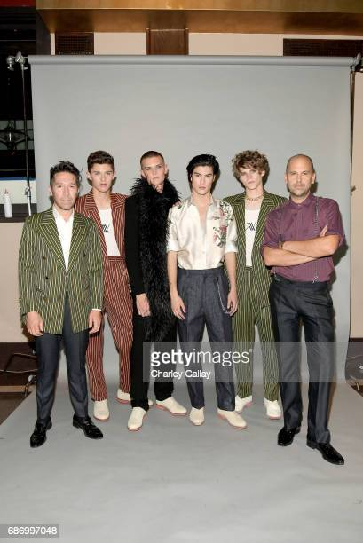 Designers Brian Wolk and Claude Morais with models at the Wolk Morais Collection 5 Fashion Show at Yamashiro on May 22 2017 in Los Angeles California