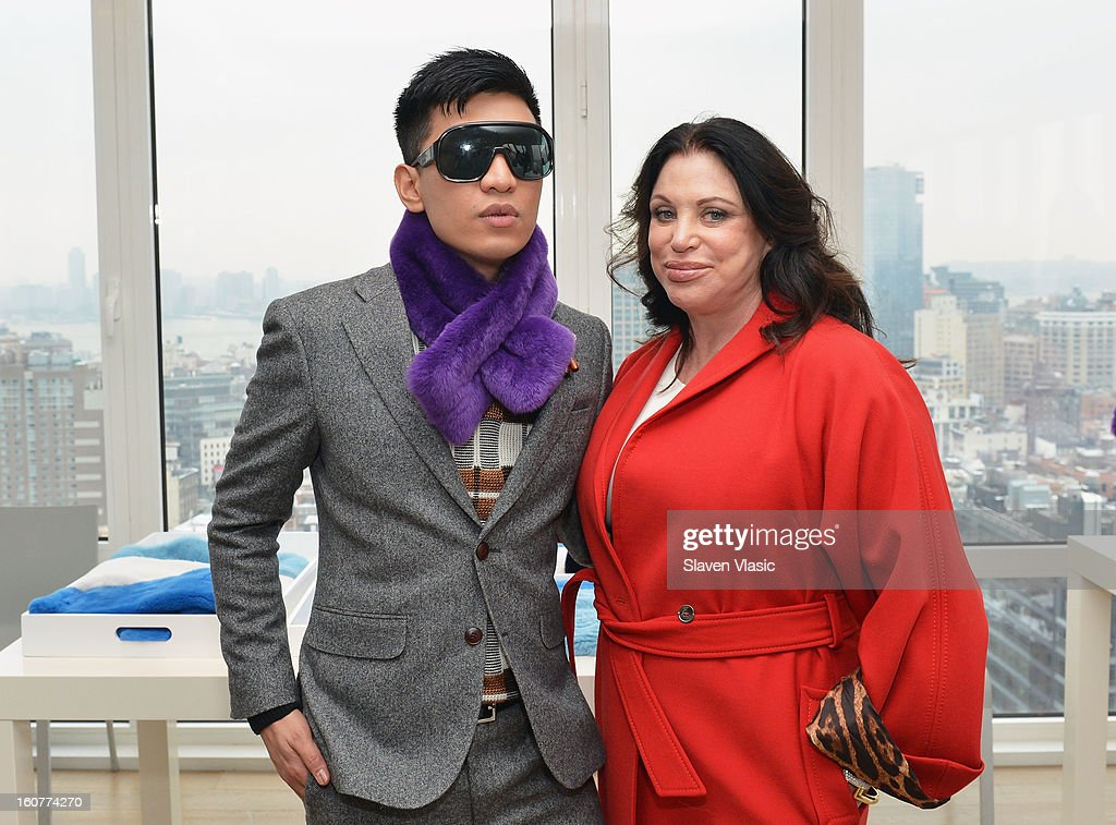 Designers Bryan Boy (L) and Adrienne Landau pose for photo at Bryan Boy For Adrienne Landau Presentation - Fall 2013 Mercedes-Benz Fashion Week at Mondrian SoHo on February 5, 2013 in New York City.