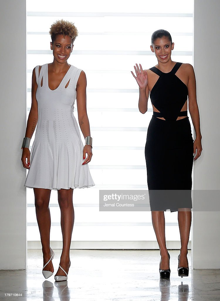 Designers <a gi-track='captionPersonalityLinkClicked' href=/galleries/search?phrase=Carly+Cushnie&family=editorial&specificpeople=5516258 ng-click='$event.stopPropagation()'>Carly Cushnie</a> and <a gi-track='captionPersonalityLinkClicked' href=/galleries/search?phrase=Michelle+Ochs&family=editorial&specificpeople=5516260 ng-click='$event.stopPropagation()'>Michelle Ochs</a> walk the runway at the Cushnie Et Ochs fashion show during MADE Fashion Week Spring 2014 at Milk Studios on September 6, 2013 in New York City.