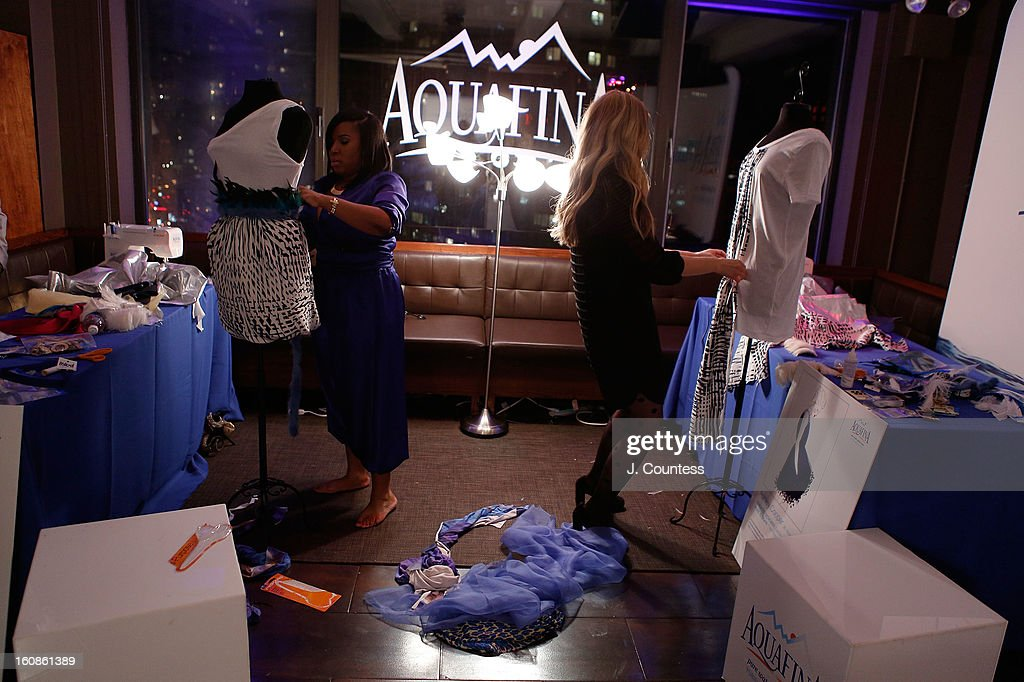 Designers Carmen Green and Ashley Cooper work on their designs during the Aquafina 'Pure Challenge' at the Aquafina 'Pure Challenge' After Party at The Empire Hotel Rooftop on February 6, 2013 in New York City.