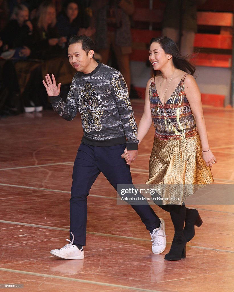 Designers <a gi-track='captionPersonalityLinkClicked' href=/galleries/search?phrase=Carol+Lim&family=editorial&specificpeople=4081625 ng-click='$event.stopPropagation()'>Carol Lim</a> and Humberto Leon walk the runway during the Kenzo Fall/Winter 2013 Ready-to-Wear show as part of Paris Fashion Week on March 3, 2013 in Paris, France.