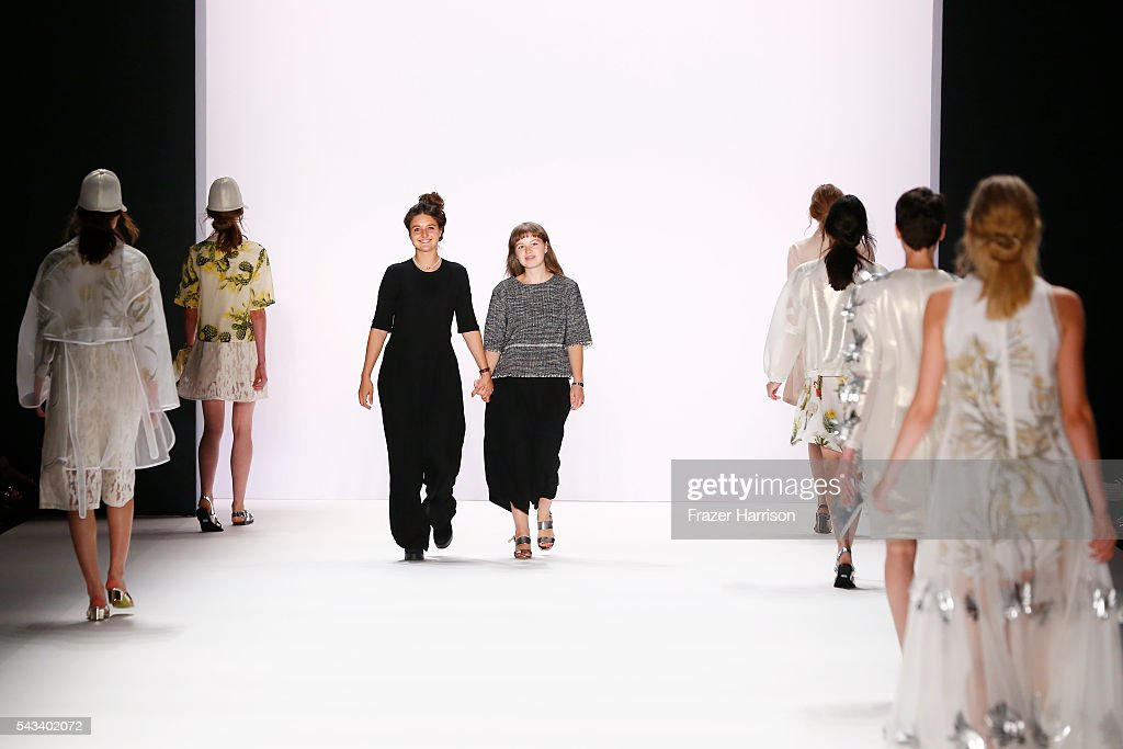 Designers Caroline Rohner and Inna Stein acknowledge the applause of the audience at the Steinrohner show during the Mercedes-Benz Fashion Week Berlin Spring/Summer 2017 at Erika Hess Eisstadion on June 28, 2016 in Berlin, Germany.