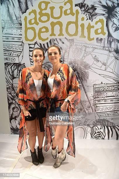 Designers Catalina Álvarez and Mariana Hinestroza pose backstage with TRESemme at the Agua Bendita show during MercedesBenz Fashion Week Swim 2014 at...