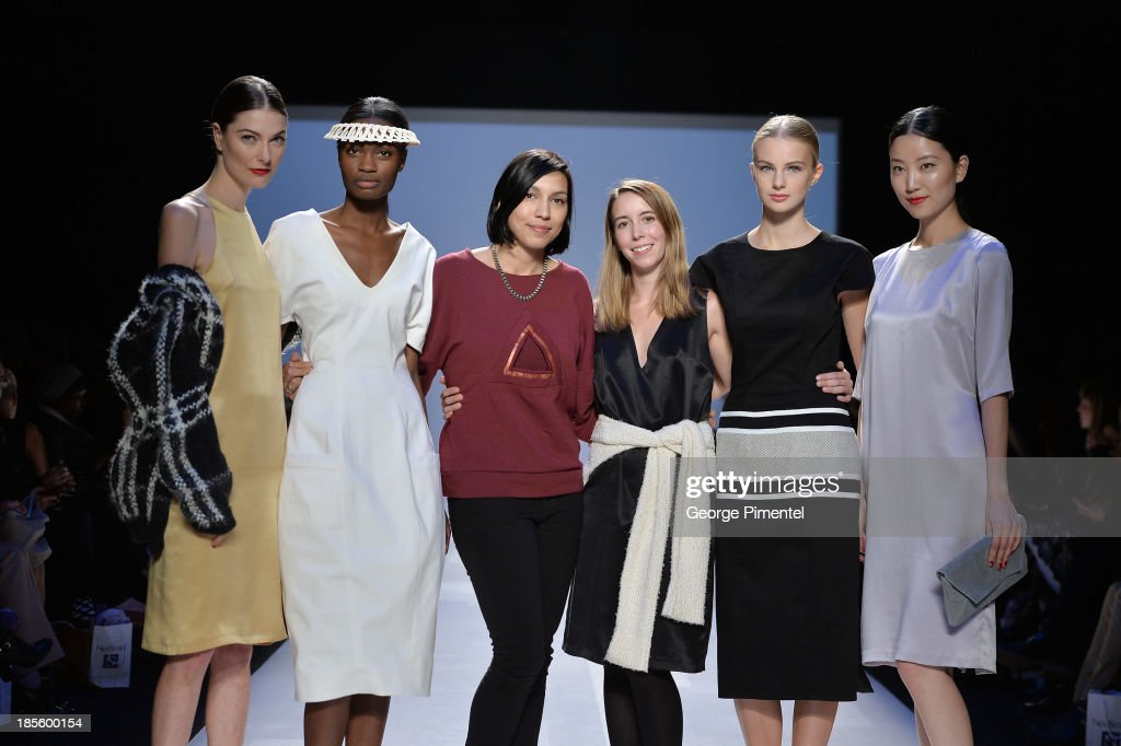 Designers Cecile Raizonville of Matiere Noire (3rd from L) and <a gi-track='captionPersonalityLinkClicked' href=/galleries/search?phrase=Malorie+Urbanovitch+-+Fashion+Designer&family=editorial&specificpeople=14230921 ng-click='$event.stopPropagation()'>Malorie Urbanovitch</a>, winners of of the Mercedes-Benz Start-Up national final, pose on the runway during World MasterCard Fashion Week Spring 2014 at David Pecaut Square on October 22, 2013 in Toronto, Canada.