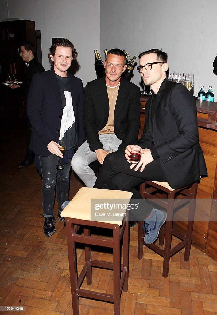 Designers Christopher Kane, Jonathan Saunders and Erdem Moralioglu attend a private dinner hosted by Matthew Slotover and Amanda Sharp to celebrate the Frieze Projects and the Emdash Awards 2012 at Central St. Martin's on October 11, 2012 in London, England.