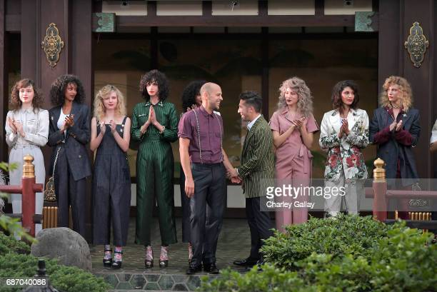 Designers Claude Morais and Brian Wolk with models at the Wolk Morais Collection 5 Fashion Show on May 22 2017 in Los Angeles California