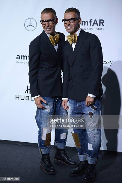 Designers Dan and Dean Caten arrive to attend the amfAR Milano 2013 at La Permanente during Milan Fashion Week on September 21 2013 AFP PHOTO /...